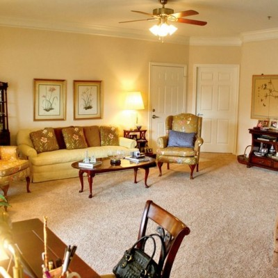 Living area with coffee table, writing desk, couch and chairs