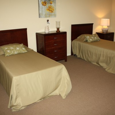 Bedroom with two twin beds, dressers and side tables
