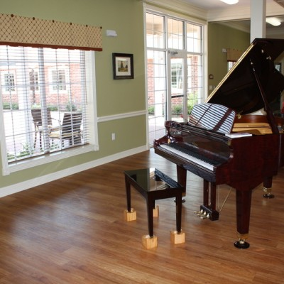 Large room with window and piano